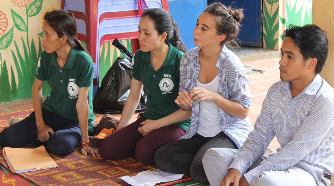 Women empowerment volunteers hold a meeting for female business owners in Cambodia.